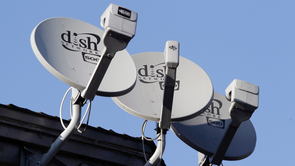 In this Feb. 23, 2011, file photo, Dish Network satellite dishes are shown at an apartment complex in Palo Alto, Calif. U.S. regulators are approving T-Mobile's $26.5 billion takeover of rival Sprint, despite fears of higher prices and job cuts. The approval on Friday, July 26, 2019, by the Justice Department and five state attorneys general comes after Sprint and T-Mobile agreed to conditions that would set up satellite-TV provider Dish as a fourth wireless company, so the number of major U.S. providers remains at four. (AP Photo/Paul Sakuma, File)