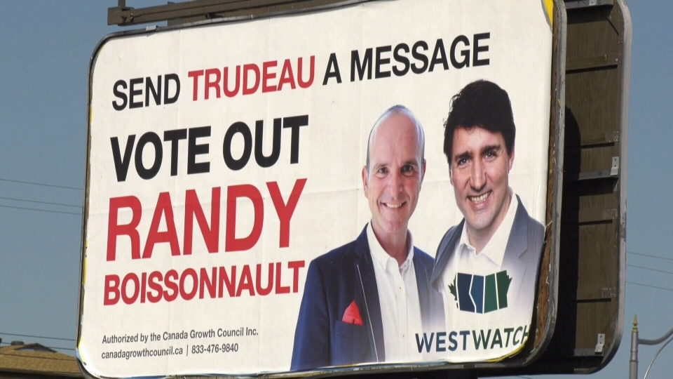 Four signs in western Canada are targeting Liberal MPs, asking voters to vote them out of office in this fall's federal election.