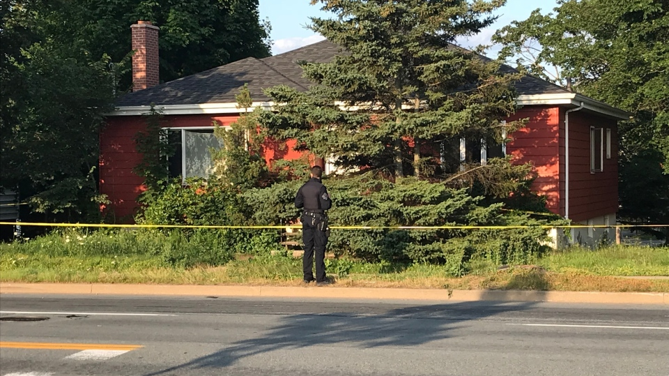 A Halifax Regional Police surveys the scene of a shooting on Joseph Howe Drive. Police tape completely encircled the house at the corner of Scot Street and Joseph Howe. (CTV ATLANTIC / JIM KVAMMEN)