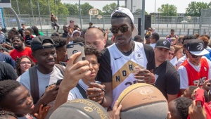 Toronto Raptors' Chris Boucher mingles with fans and signing basketballs during a homecoming visit following the Raptors' NBA championship win over the Golden State Warriors, in Montreal on Friday, July 26, 2019. (THE CANADIAN PRESS/Ryan Remiorz)