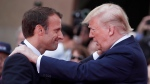 In this Thursday, June 6, 2019 file photo French President Emmanuel Macron, left, meets U.S President Donald Trump during a ceremony to mark the 75th anniversary of D-Day at the Normandy American Cemetery in Colleville-sur-Mer, Normandy, France. (Ian Langsdon/POOL via AP, File)