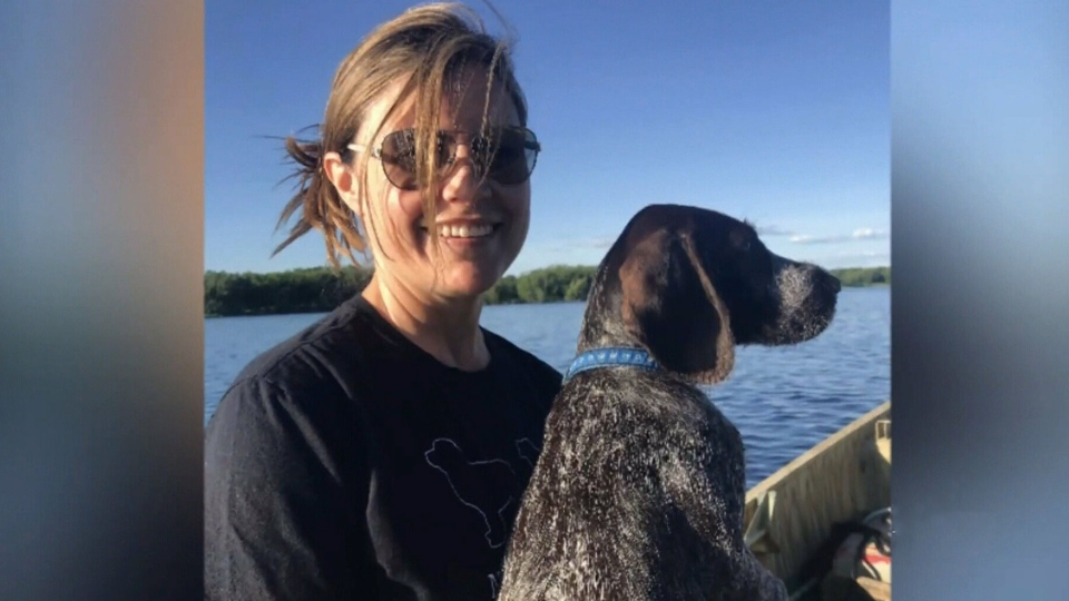 Sandy Kitchen-Brewer is pictured with her dog Flint who passed away earlier this month after ingesting toxins from blue-green algae.