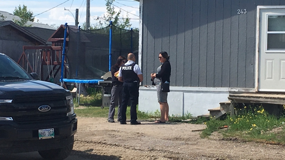 RCMP officers are now knocking on doors looking for clues, and will continue to do so over the next couple of days in Gillam and Fox Lake Cree Nation. (Photo: Jeff Keele/CTV News Winnipeg)