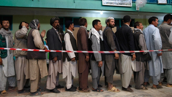 Afghan men wait on line to vote at a polling station in a mosque in Kabul, Afghanistan, Thursday, Aug. 20, 2009. (AP / Kevin Frayer)