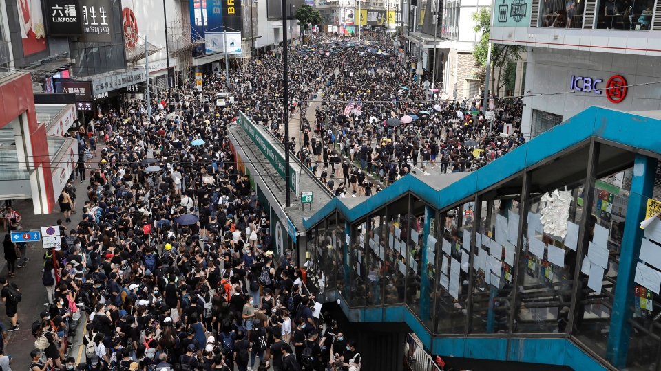 Protesters take part in a march on a street in Hong Kong, Sunday, July 28, 2019. (AP Photo/Vincent Yu)