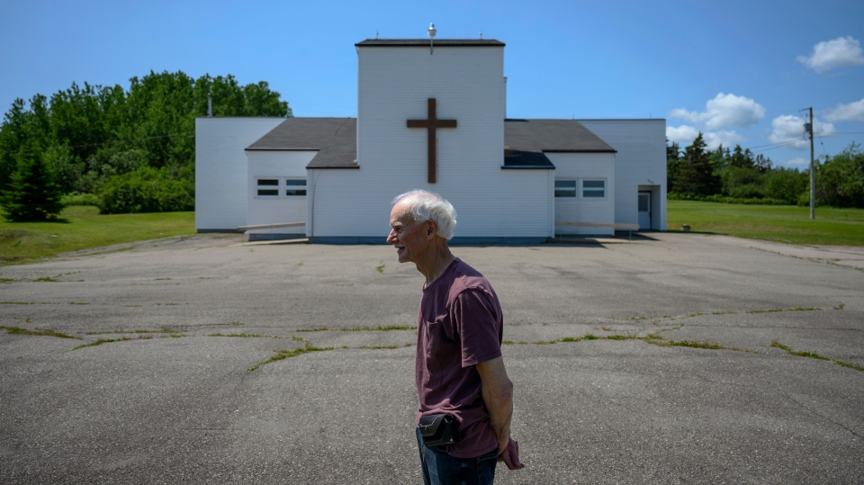Rod Farrell, a warden at the Church of St. Barra, poses in front of the church closed by the Diocese of Antigonish in Christmas Island, Cape Breton, N.S. on Friday, July 26, 2019. (THE CANADIAN PRESS / Darren Calabrese)