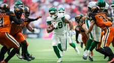 Saskatchewan Roughriders' William Powell, centre, runs the ball during the second half of a CFL football game against the B.C. Lions, in Vancouver, on Saturday July 27, 2019. THE CANADIAN PRESS/Darryl Dyck