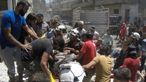 This photo provided by the Syrian Civil Defense White Helmets, shows Syrian White Helmet civil defense workers and civilians carry an injured man on a stretcher after an airstrike hit the northern town of Ariha, in Idlib province, Syria, Sunday, July 28, 2019. Syrian opposition activists and a war monitor say five people have been killed in airstrikes on a town in the country's northwest as the government keeps up its deadly air campaign on the rebel-controlled region. (Syrian Civil Defense White Helmets via AP)