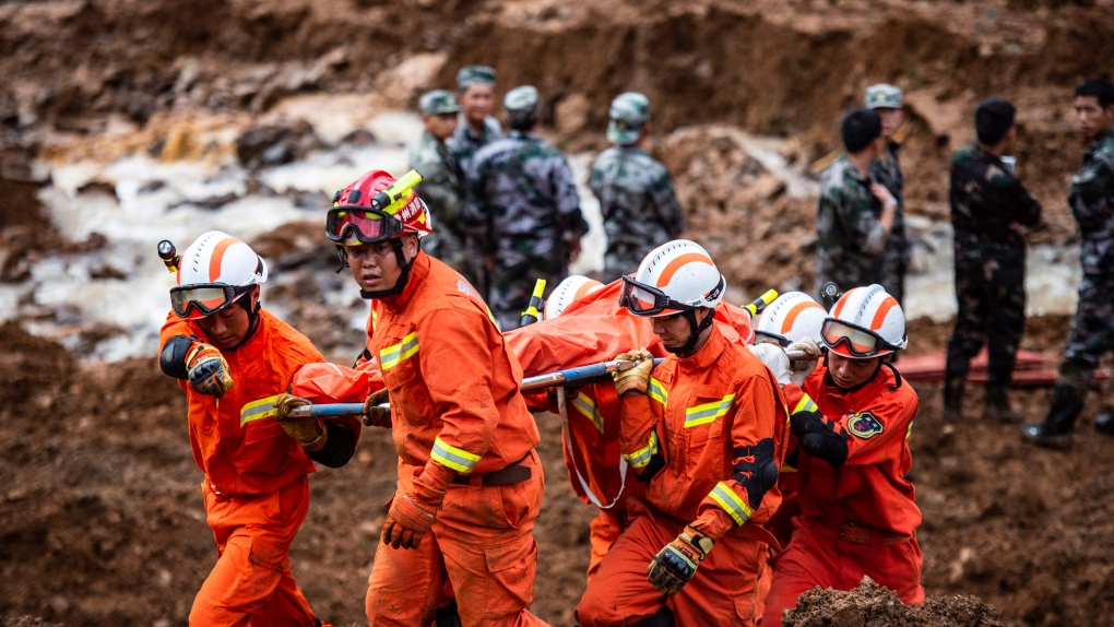 Death toll rises to 38 in China landslide, 13 still missing