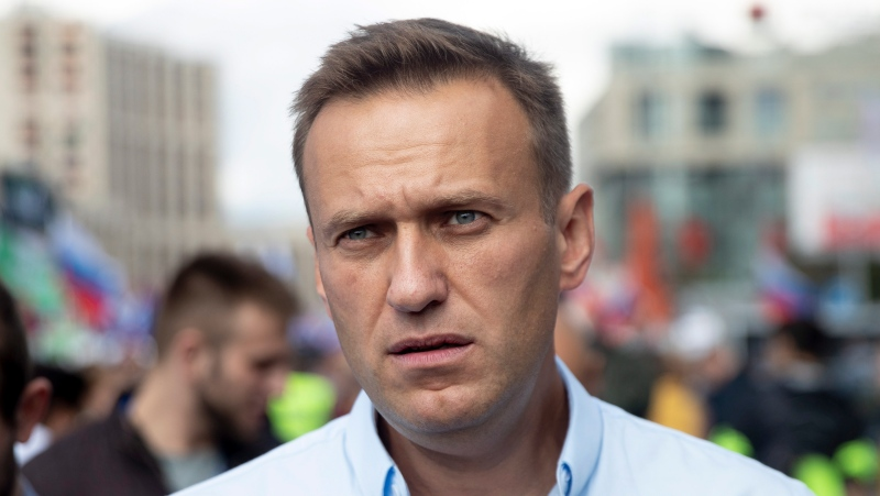 In this file photo taken on Saturday, July 20, 2019, Russian opposition activist Alexei Navalny attends a protest in Moscow, Russia. (AP Photo/Pavel Golovkin, File)