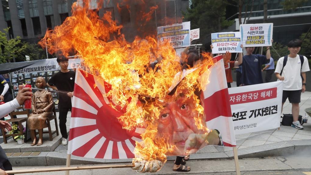 South Korean students burn a banner in Seoul