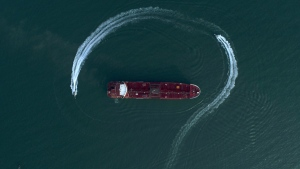 Speedboats from Iran's Revolutionary Guard circle the British-flagged oil tanker Stena Impero in the Iranian port of Bandar Abbas, on July 21, 2019. (Morteza Akhoondi / Tasnim News Agency via AP)