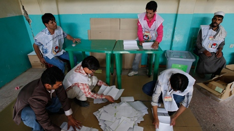 Afghan election workers count ballots after polls closed at a polling station in a mosque in Kabul, Thursday Aug. 20, 2009. (AP / Kevin Frayer)