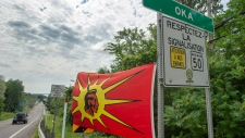 Mohawk flags are placed at the border of the Kanasatake Mohawk territory and the town of Oka Friday, July 19, 2019 in Oka, Que. (THE CANADIAN PRESS/Ryan Remiorz)