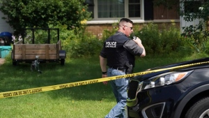 A Lake Hallie Police officer works outside a home Monday, July 29, 2019, in Lake Hallie, Wis., following a shooting the night before. Authorities in northwestern Wisconsin say shootings at two homes have left five people dead, including the suspected shooter, and two others injured. (Renee Jones Schneider/Star Tribune via AP)