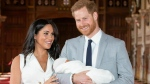 In this Wednesday May 8, 2019 file photo, Britain's Prince Harry and Meghan, Duchess of Sussex, during a photocall with their newborn son, in St George's Hall at Windsor Castle, England. (Dominic Lipinski/Pool via AP, file)