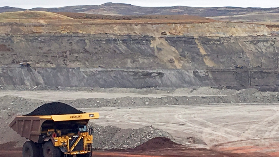 In this March 28, 2017, file photo, a dump truck hauls coal at Contura Energy's Eagle Butte Mine near Gillette, Wyo. Mine owner Blackjewel LLC of Milton, W.Va., says it has filed for Chapter 11 bankruptcy protection. Blackjewel operates mines in Wyoming, Kentucky, Virginia and West Virginia. Kentucky miners are now blocking train tracks in protest over unpaid wages. (AP Photo/Mead Gruver, File)