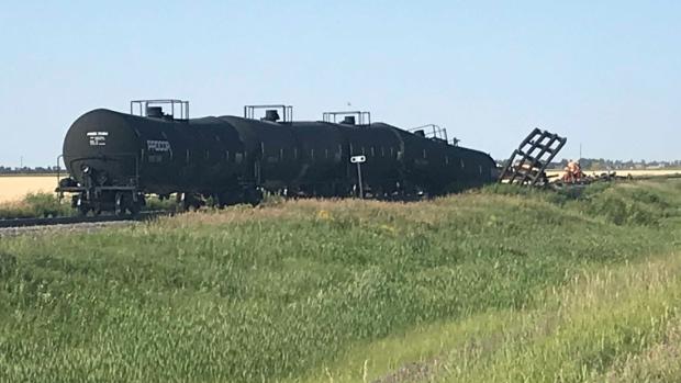 Train derails, rail bridge collapses near La Salle