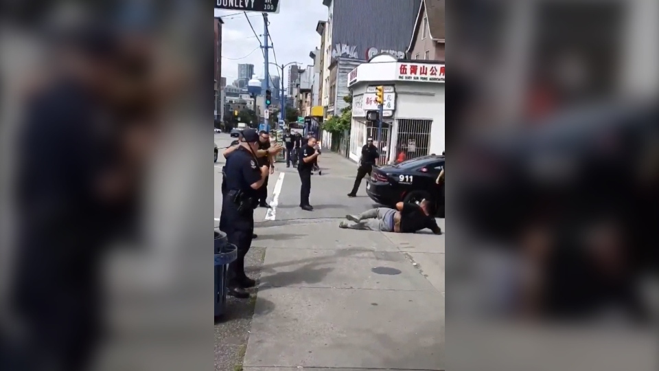 A dramatic takedown on Vancouver's Downtown Eastside is seen in this social media image from July 30, 2019. (@stopdisplacement / Twitter)