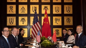 Chinese Vice Premier Liu He, right, sits with U.S. Trade Representative Robert Lighthizer, second from left, and Treasury Secretary Steve Mnuchin, left, before the start of talks at the Xijiao Conference Center in Shanghai Wednesday, July 31, 2019. (AP Photo/Ng Han Guan, Pool)