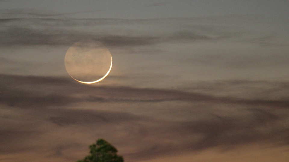 In this Jan. 9, 2008, file photo, one day past New, an early Waxing Crescent Moon is seen just after sunset from Tyler, Texas. (AP Photo/Dr. Scott M. Lieberman, File)