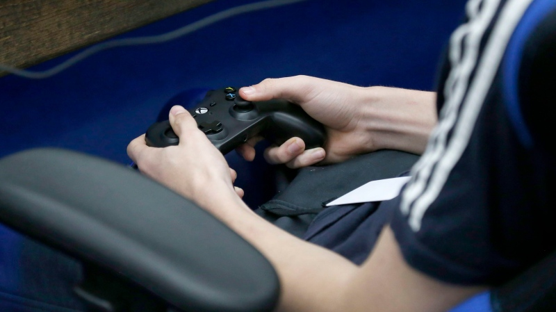 A student plays a video game in Sapulpa, Okla. on April 3, 2019. A spate of recent high-profile crimes allegedly perpetrated by young men with a passion for video games is prompting industry watchers to raise cautions against reading too much into their hobbies. THE CANADIAN PRESS/AP, Stephen Pingry-Tulsa World