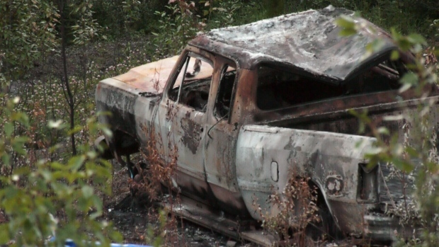 A pickup truck driven by Kam McLeod and Bryer Schmegelsky is seen burned and abandoned at the side of a B.C. highway.