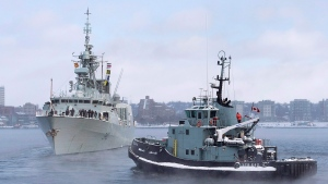 The naval tugboat Glenivis assists as HMCS St. John's heads to the Mediterranean in Halifax on Monday, Jan. 9, 2017. The Halifax-class frigate will be supporting NATO Maritime Group 2 as part of Operation Reassurance. THE CANADIAN PRESS/Andrew Vaughan