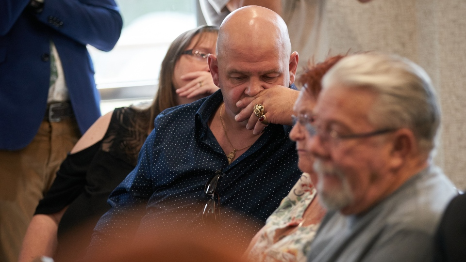Arpad Horvath Jr., who's father was a victim of Elizabeth Wettlaufer listens to a question during the presentation of the report of the Public Inquiry into the Safety and Security of Residents in the Long-Term Care Homes System in Woodstock, Ont. on Wednesday, July 31, 2019. THE CANADIAN PRESS/ Geoff Robins