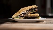 A mushroom panino featuring almond feta