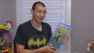Philip Yang shows off his comic book collection at his Toronto home.