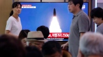 People watch a TV showing a file image of North Korea's missile launch during a news program at the Seoul Railway Station in Seoul, South Korea, Wednesday, July 31, 2019. (AP Photo/Ahn Young-joon)