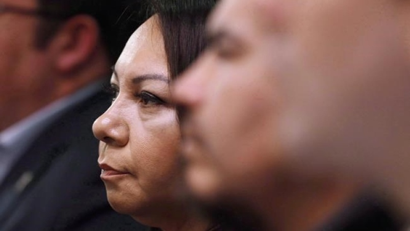Sheila North Wilson, grand chief of Manitoba Keewatinowi Okimakanak, listens to an RCMP announcement at a press conference in Winnipeg, Friday, March 18, 2016. THE CANADIAN PRESS/John Woods