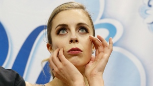 FILE - In this Jan. 5, 2018, file photo, Ashley Wagner waits for her scores during the women's free skate event at the U.S. Figure Skating Championships in San Jose, Calif. Former Olympian Ashley. (AP Photo/Tony Avelar, File)