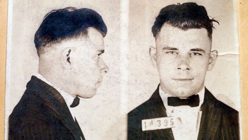 This file photo shows Indiana Reformatory booking shots of John Dillinger, stored in the state archives, and shows the notorious gangster as a 21-year-old. Records show that Dillinger was admitted into the reformatory on Sept. 16, 1924. (AP Photo/The Indianapolis Star, Charlie Nye, File)