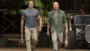 Dwayne Johnson, left, and Jason Statham in a scene from 'Fast & Furious Presents: Hobbs & Shaw.' (Frank Masi / Universal Pictures via AP)