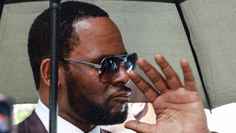 In this June 26, 2019, file photo, Musician R. Kelly departs from the Leighton Criminal Court building after a status hearing in his criminal sexual abuse trial in Chicago. (AP Photo/Amr Alfiky)