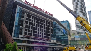 Workers prepare to install a new video board and signage outside of the Scotiabank Arena in Toronto on Wednesday, July 31, 2019. While the Maple Leafs and Raptors gear up for next season, Scotiabank Arena is getting a multimillion-dollar facelift. THE CANADIAN PRESS/Neil Davidson
