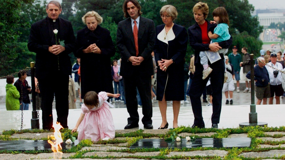 In this June 6, 2000 file photo, Robert F. Kennedy's granddaughter Saoirse Kennedy Hill places a white rose at the Eternal Flame, President John F. Kennedy's gravesite, at Arlington National Cemetery in Arlington, Va. Hill, has died at the age of 22. (AP Photo/Hillery Smith Garrison, File)