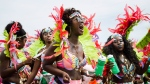 Revellers take part in the Caribbean Carnival Grand Parade in Toronto, on Saturday, Aug.4, 2018. THE CANADIAN PRESS/Christopher Katsarov
