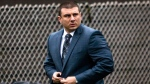 In this May 13, 2019, file photo, New York City Police Officer Daniel Pantaleo leaves his house in the Staten Island borough of New York. An administrative judge on Friday, Aug. 2,2019,  has recommended firing Pantaleo, a New York City police officer accused of using a chokehold in the 2014 death of Eric Garner. (AP Photo/Eduardo Munoz Alvarez, File)