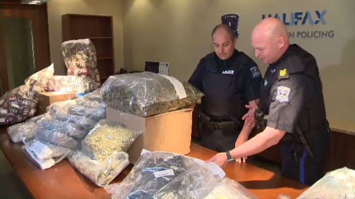Halifax police display the cash and product seized at two Halifax-area cannabis dispensaries that were raided. Four people were arrested and charged with possession. (CTV ATLANTIC / CARL POMEROY)