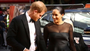 Prince Harry, left, and Meghan, Duchess of Sussex, poses for photographers upon arrival at the 'Lion King' European premiere in central London, Sunday, July 14, 2019. (Photo by Joel C Ryan / Invision / AP)