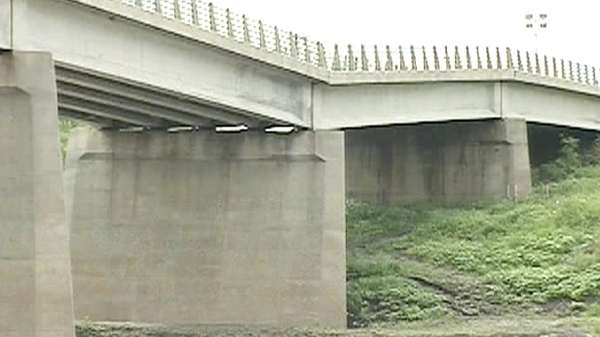 The bridge on Provincial Road 210 is shown on the brink of collapse near St. Adolphe, Man. on Friday, Aug. 21, 2009.