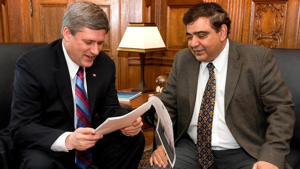 Conservative MP Deepak Obhrai, right, can be seen with former prime minister Stephen Harper in this undated photo. (Deepak Obhrai parliamentary website)