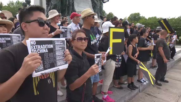 Dozens of people wearing black gathered in Mount Royal Park on Sat., Aug. 3, 2019 to express solidarity with demonstrators in Hong Kong.