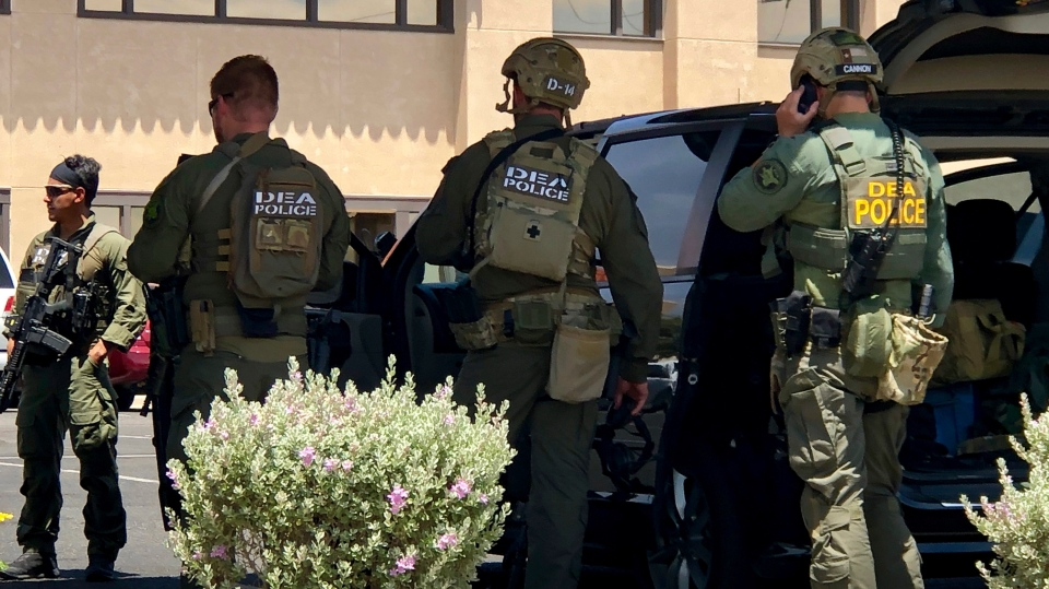Law enforcement from different agencies work the scene of a shooting at a shopping mall in El Paso, Texas, on Saturday, Aug. 3, 2019. (AP Photo/Rudy Gutierrez)