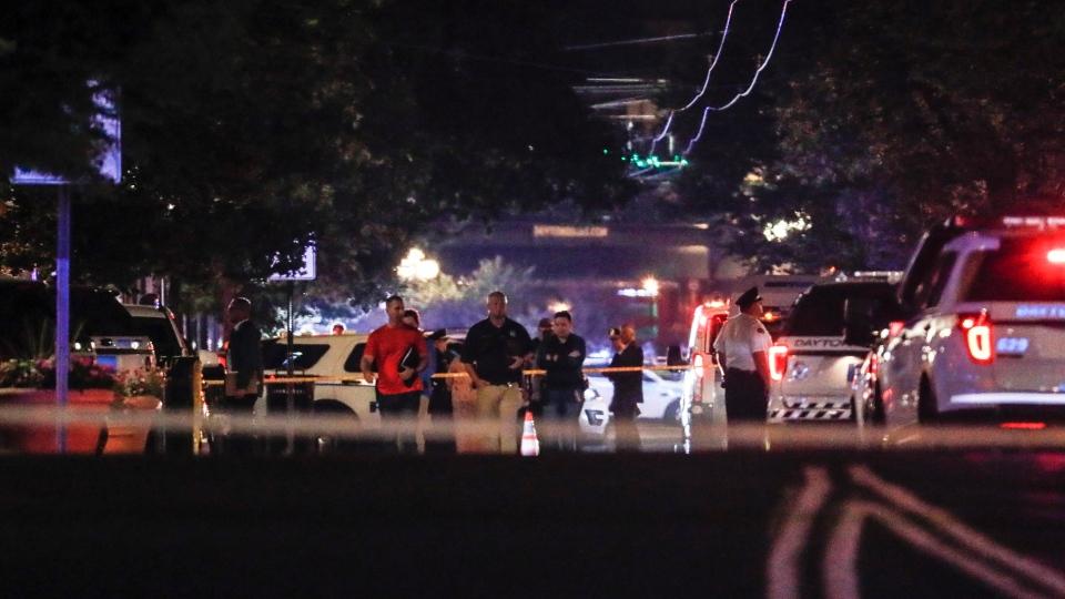 Authorities work the scene of a mass shooting, Sunday, Aug. 4, 2019, in Dayton, Ohio. (AP Photo/John Minchillo)