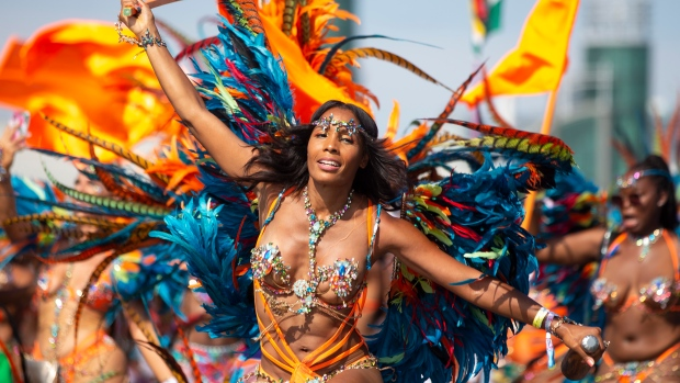 A masquerader takes part in Toronto's Caribbean Carnival festival on Saturday, Aug. 3, 2019. THE CANADIAN PRESS/Chris Young