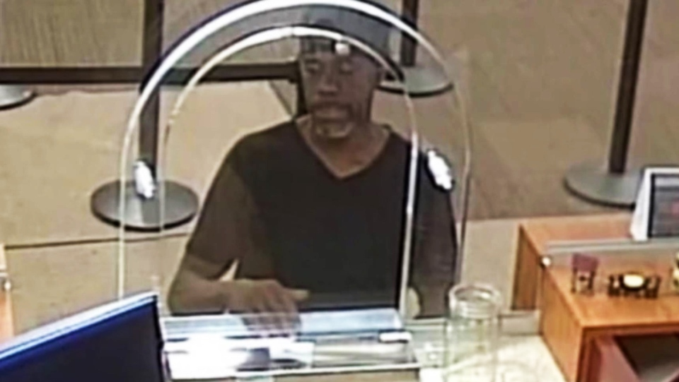 The FBI says a man robbed a bank in Cleveland after passing a teller a note written on a document containing his name and home address. (WJW-TV / CNN)